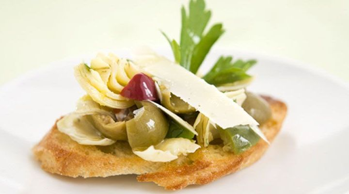 Crostini of Artichokes, Picholine Olives and Shaved Parmesan Recipe